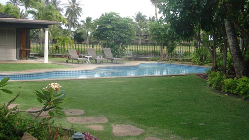 View of pool and yard